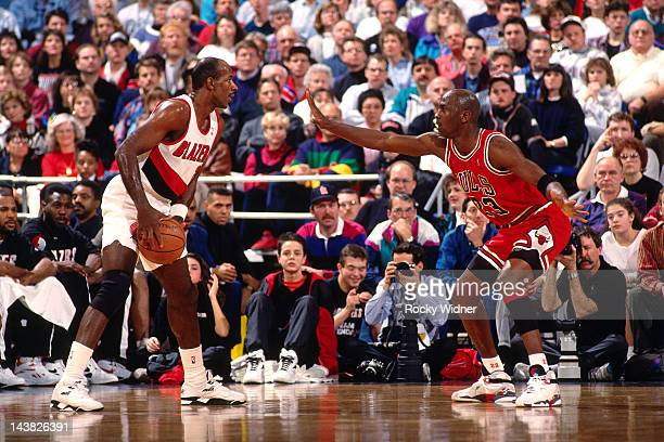 Michael Jordan of the Chicago Bulls defends against Clyde Drexler of the Portland Trailblazers on February 7 1993 at Veterans Memorial Coliseum in...
