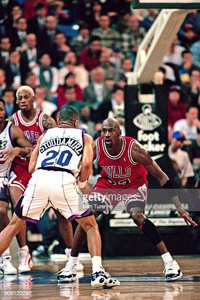 Michael Jordan of the Chicago Bulls defends against Damon Stoudamire of the Toronto Raptors on January 18 1996 at SkyDome in Toronto Canada NOTE TO...