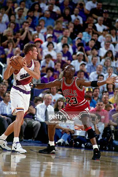 Michael Jordan of the Chicago Bulls defends against Dan Majerle of the Phoenix Suns in Game One of the 1993 NBA Finals on June 9 1993 at the America...