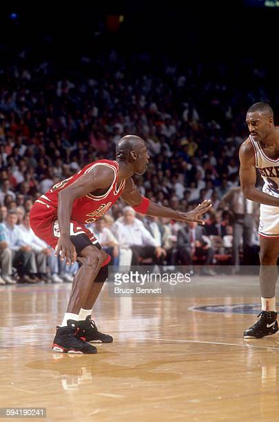 Michael Jordan of the Chicago Bulls defends against Hersey Hawkins of the Philadelphia 76ers during a game in the 1991 Eastern Conference Semifinals...