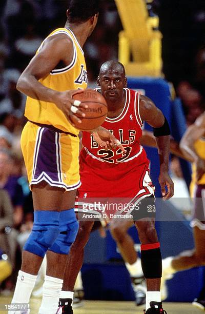 Michael Jordan of the Chicago Bulls defends against Magic Johnson of the Los Angeles Lakers during Game 5 of the 1991 NBA Championship Finals on June...