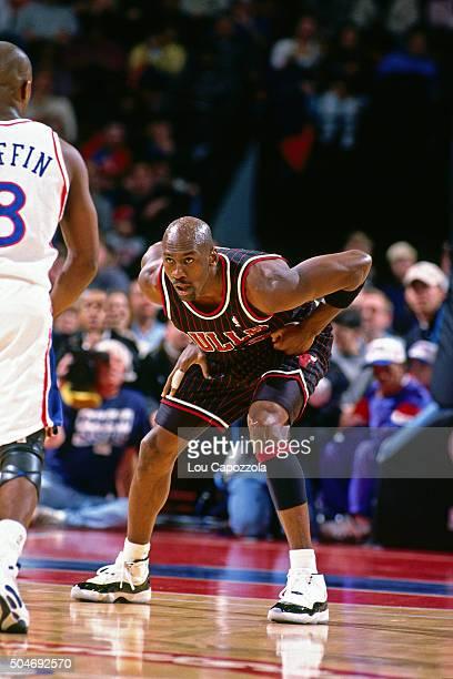 Michael Jordan of the Chicago Bulls defends against the Philadelphia 76ers on January 13 1996 at the Spectrum in Philadelphia Pennsylvania The...