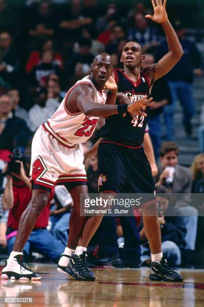 Michael Jordan of the Chicago Bulls defends Jerry Stackhouse of the Philadelphia 76ers during a game played on November 1 1997 at the First Union...