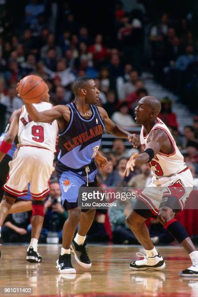 Michael Jordan of the Chicago Bulls defends Terrell Brandon of the Cleveland Cavaliers on February 20 1996 at the United Center in Chicago Illinois...