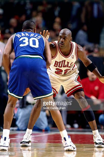 Michael Jordan of the Chicago Bulls digs in on defense during a 1996 NBA game at the United Center in Chicago Illinois NOTE TO USER User expressly...