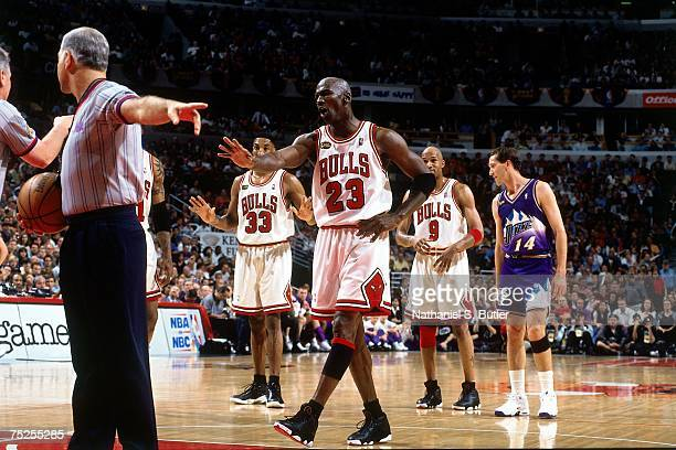 Michael Jordan of the Chicago Bulls discusses a call with an official against the Utah Jazz in Game Five of the 1998 NBA Finals at the United Center...