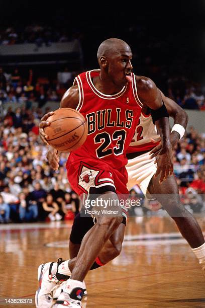 Michael Jordan of the Chicago Bulls dribbles against Clyde Drexler of the Portland Trailblazers on February 7 1993 at Veterans Memorial Coliseum in...