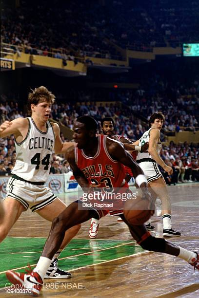 Michael Jordan of the Chicago Bulls dribbles against Danny Ainge of the Boston Celtics during Game 2 of the Eastern Conference quarterfinals during...