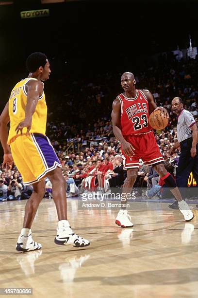 Michael Jordan of the Chicago Bulls dribbles against Kobe Bryant of the Los Angeles Lakers on February 1 1998 at The Forum in Inglewood California...