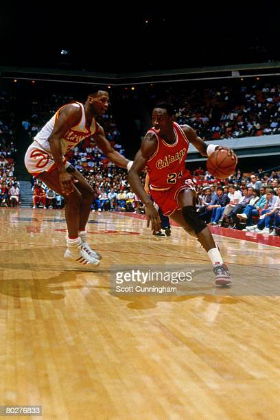 Michael Jordan of the Chicago Bulls dribbles against the Atlanta Hawks during his rookie season of 1984 at the Omni in Atlanta Georgia NOTE TO USER...