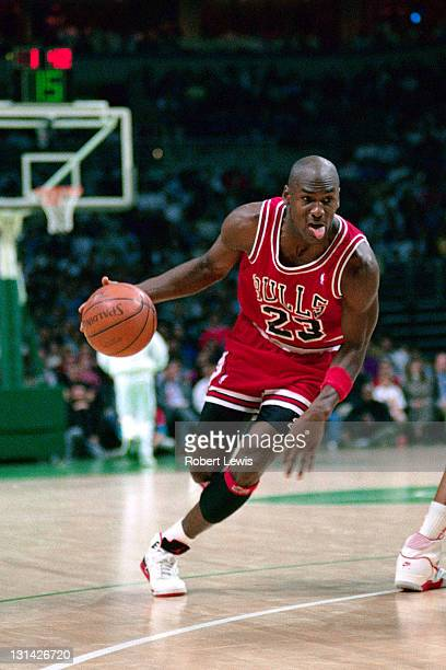 Michael Jordan of the Chicago Bulls dribbles against the Milwaukee Bucks circa 1988 at the Bradley Center in Milwaukee Wisconsin NOTE TO USER User...
