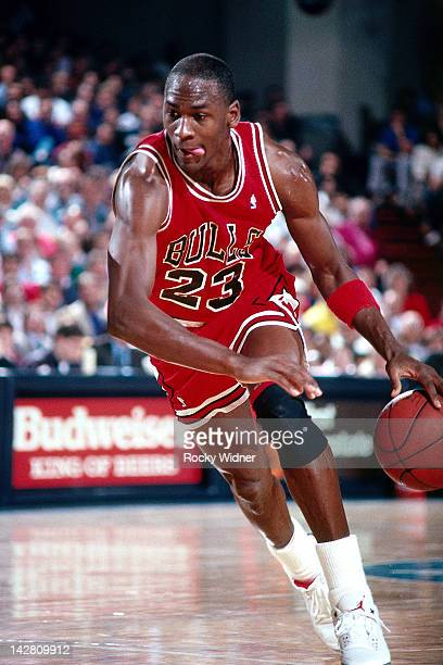Michael Jordan of the Chicago Bulls dribbles against the Sacramento Kings during a game played on February 1 1988 at the Arco Arena in Sacramento...