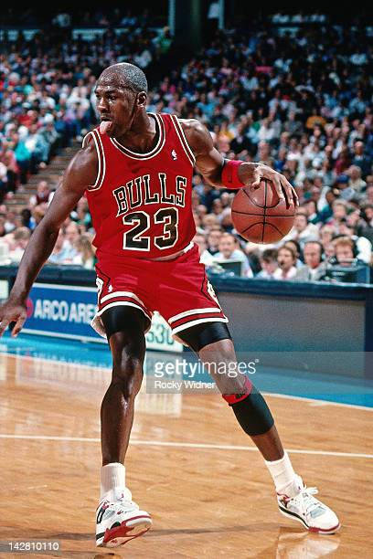 Michael Jordan of the Chicago Bulls dribbles against the Sacramento Kings during a game played on November 14 1989 at the Arco Arena in Sacramento...