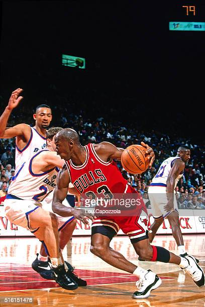 Michael Jordan of the Chicago Bulls dribbles against the Washington Bullets on April 21 1996 at the Capitol Center in Landover Maryland NOTE TO USER...