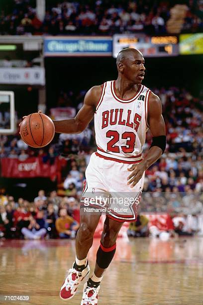 Michael Jordan of the Chicago Bulls dribbles during a game played circa 1992 at Chicago Stadium in Chicago Illinois NOTE TO USER User expressly...