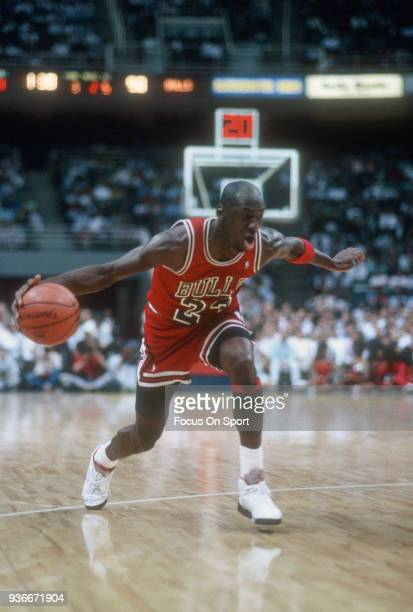 Michael Jordan of the Chicago Bulls dribbles the ball against the Miami Heat during an NBA basketball game circa 1988 at the Miami Arena in Miami...