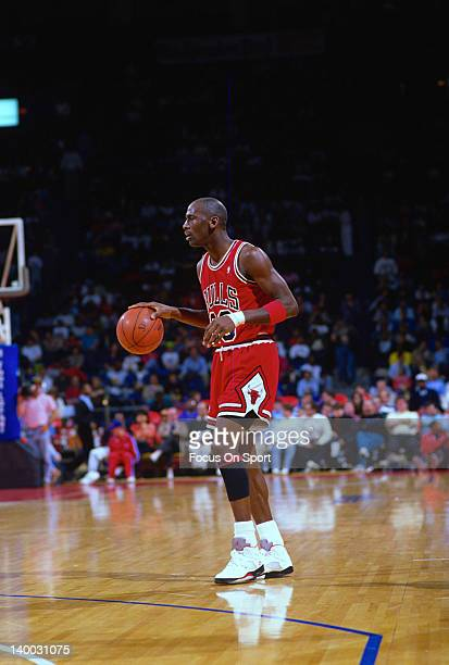 Michael Jordan of the Chicago Bulls dribbles the ball up court against the Washington Bullets during an NBA basketball game circa 1989 at the Capital...