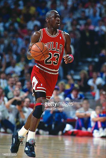 Michael Jordan of the Chicago Bulls dribbles the ball up court against the Washington Bullets during an NBA basketball game circa 1990 at the Capital...