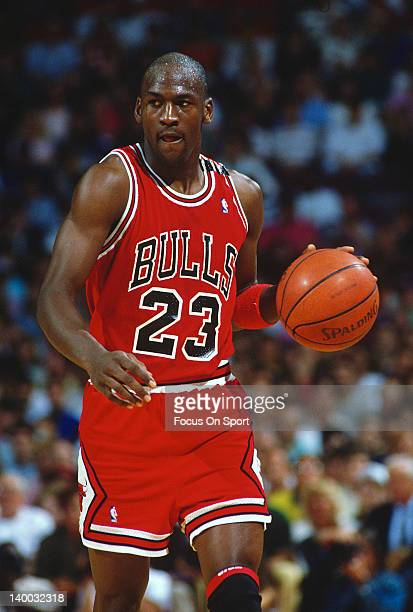 Michael Jordan of the Chicago Bulls dribbles the ball up court against the Washington Bullets during an NBA basketball game circa 1993 at the Capital...