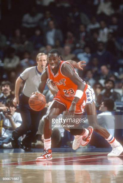 Michael Jordan of the Chicago Bulls dribbles the ball up court against the Washington Bullets during an NBA basketball game circa 1985 at the Capital...