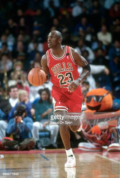Michael Jordan of the Chicago Bulls dribbles the ball up court against the Washington Bullets during an NBA basketball game circa 1992 at the Capital...