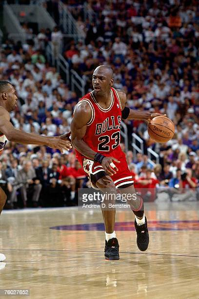 Michael Jordan of the Chicago Bulls dribbles upcourt against the Phoenix Suns in Game Two of the 1993 NBA Finals on June 11 1993 at the America West...