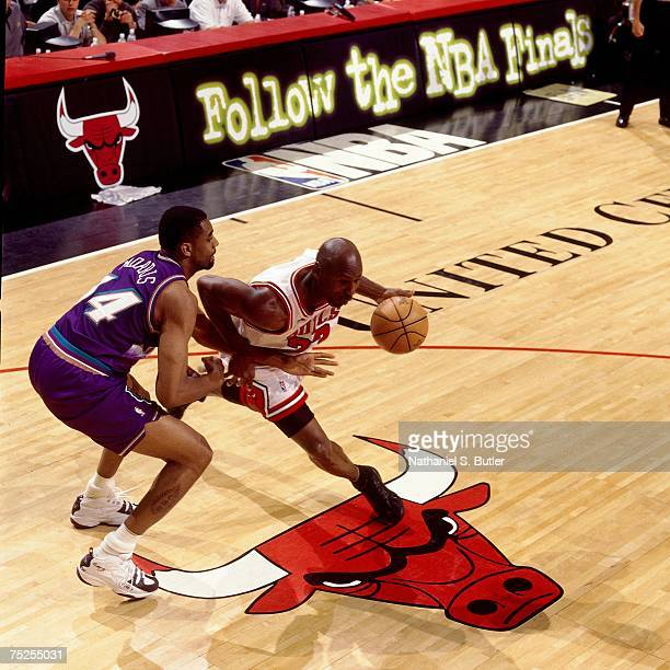 Michael Jordan of the Chicago Bulls drives against Chris Morris of the Utah Jazz in Game Three of the 1998 NBA Finals at the United Center on June 5...
