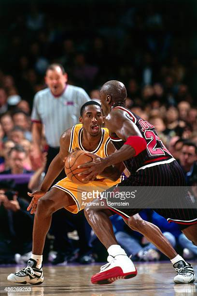 Michael Jordan of the Chicago Bulls drives against Kobe Bryant of the Los Angeles Lakers on February 5 1997 at the Great Western Forum in Inglewood...