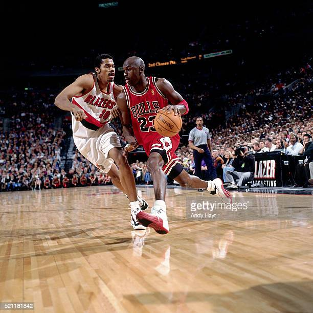 Michael Jordan of the Chicago Bulls drives against Rasheed Wallace of the Portland TrailBlazers at the Rose Garden on February 4 1997 in Portland...