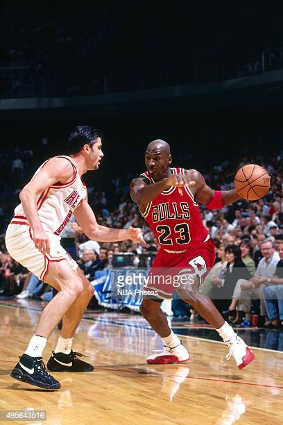 Michael Jordan of the Chicago Bulls drives against the Miami Heat on November 6 1996 at Miami Arena in Miami Florida NOTE TO USER User expressly...