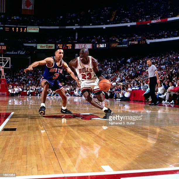 Michael Jordan of the Chicago Bulls drives against the New York Knicks during Game Three of the 1993 NBA Playoff Semifinals at Chicago Stadium in...