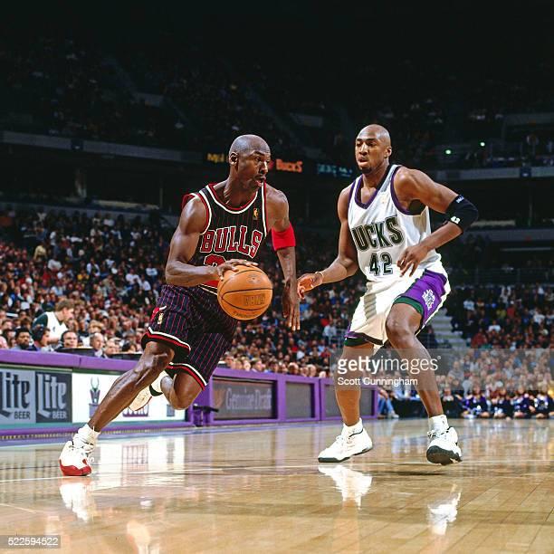 Michael Jordan of the Chicago Bulls drives against Vin Baker of the Milwaukee Bucks on January 10 1997 at the Bradley Center in Milwaukee Wisconsin...