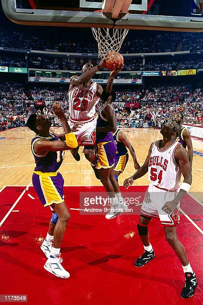 Michael Jordan of the Chicago Bulls drives and moves the basketball to his left hand in midair against the Los Angeles Lakers during Game 2 of the...