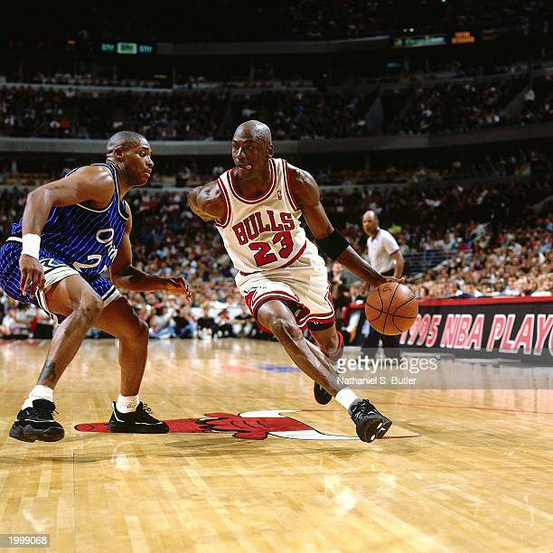 Michael Jordan of the Chicago Bulls drives baseline against Nick Anderson of the Orlando Magic in Game three of the Eastern Conference Semifinals...