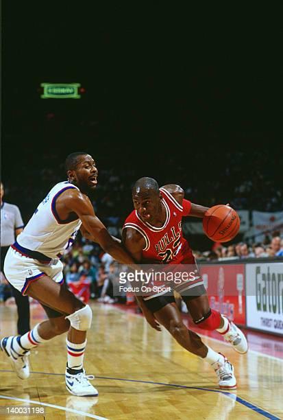 Michael Jordan of the Chicago Bulls drives on Darrell Walker of the Washington Bullets during an NBA basketball game circa 1990 at the Capital Centre...