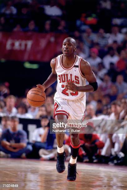 Michael Jordan of the Chicago Bulls drives the ball up court against the Portland Trail blazers during game six of the NBA Finals played on June 14...