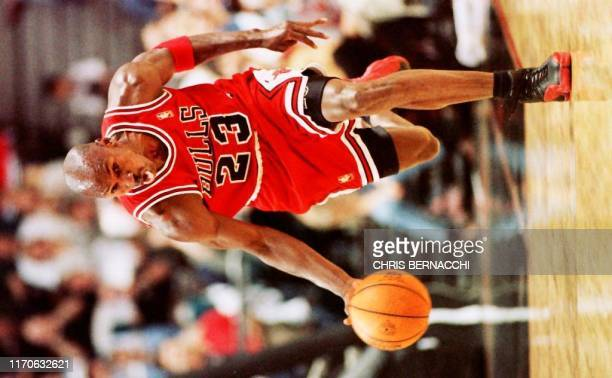 Michael Jordan of the Chicago Bulls drives the ball up court during the 3rd game of the Eastern Conference finals at the Miami Arena in Miami Florida...