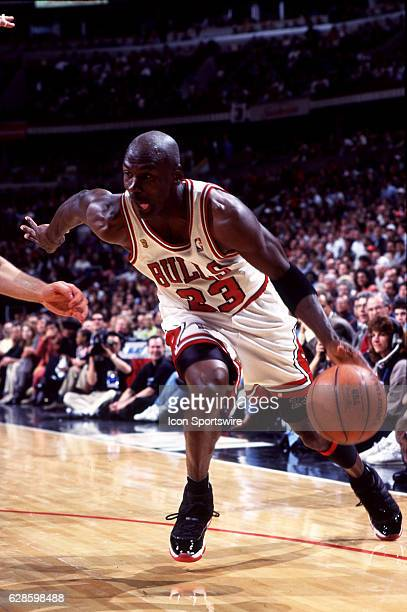Michael Jordan of the Chicago Bulls drives the baseline during a Bulls NBA Finals game versus the Seattle SuperSonics at the United Center in Chicago...