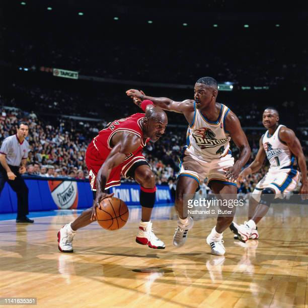 Michael Jordan of the Chicago Bulls drives through the paint during the game against Joe Dumars of the Detroit Pistons on April 15 1998 at The Palace...