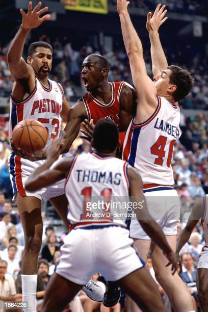 Michael Jordan of the Chicago Bulls drives to basket against the Detroit Pistons during the 1989 season NBA game in Detroit, Michigan. NOTE TO USER:...