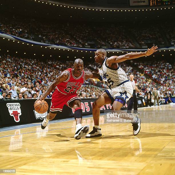 Michael Jordan of the Chicago Bulls drives to the basket against Nick Anderson of the Orlando Magic in Game two of the Eastern Conference Semifinals...