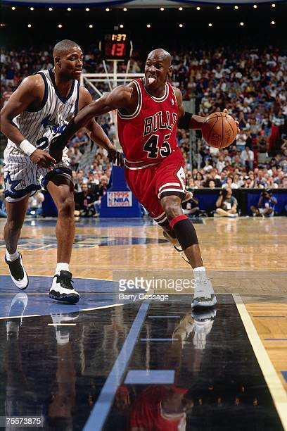 Michael Jordan of the Chicago Bulls drives to the basket against Nick Anderson of the Orlando Magic in Game One of the 1995 Easter Conference...