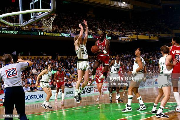 Michael Jordan of the Chicago Bulls drives to the basket against Larry Bird of the Boston Celtics during a game circa 1986 at the Boston Garden in...