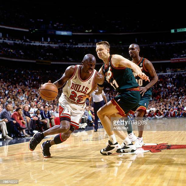 Michael Jordan of the Chicago Bulls drives to the basket against Detlef Schrempf of the Seattle SuperSonics during Game Two of the 1996 NBA Finals at...