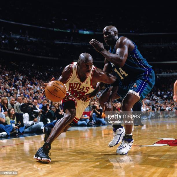 Michael Jordan of the Chicago Bulls drives to the basket against Anthony Mason of the Charlotte Hornets in Game Two of the Eastern Conference...