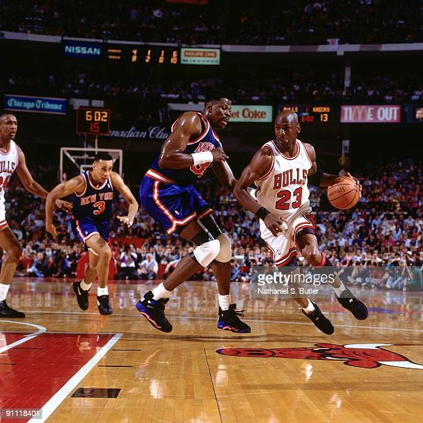 Michael Jordan of the Chicago Bulls drives to the basket against Patrick Ewing of the Chicago Bulls during Game Four of the Eastern Conference Finals...