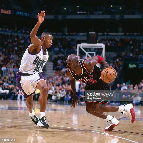 Michael Jordan of the Chicago Bulls drives to the basket against Ray Allen of the Milwaukee Bucks during the game on January 10 1997 at the Bradley...
