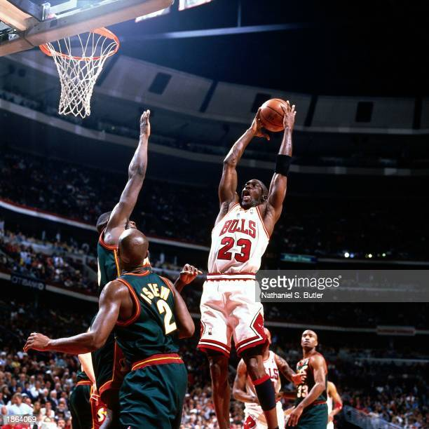 Michael Jordan of the Chicago Bulls drives to the basket against the Seattle SuperSonics during Game Two of the 1996 NBA Championship Finals at...