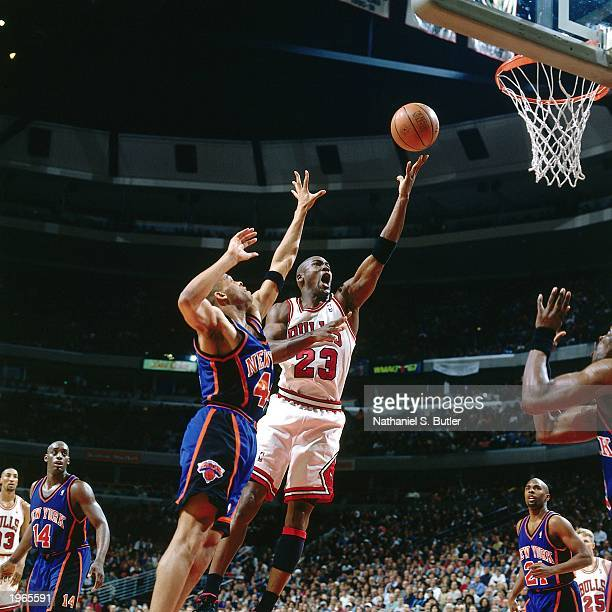 Michael Jordan of the Chicago Bulls drives to the basket against the New York Knicks in Game one of the Eastern Conference Semifinals during the 1996...
