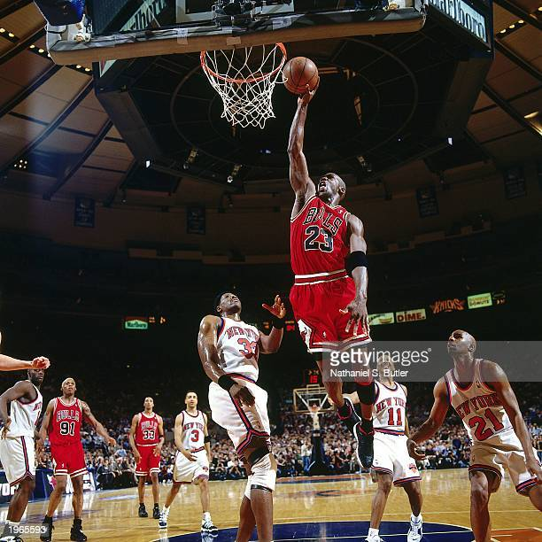 Michael Jordan of the Chicago Bulls drives to the basket against the New York Knicks in Game three of the Eastern Conference Semifinals during the...